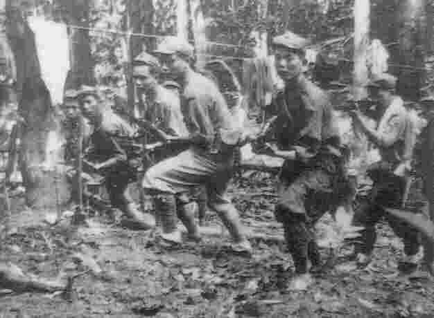 Training camp of the Malayan insurgents. Photo: IWM